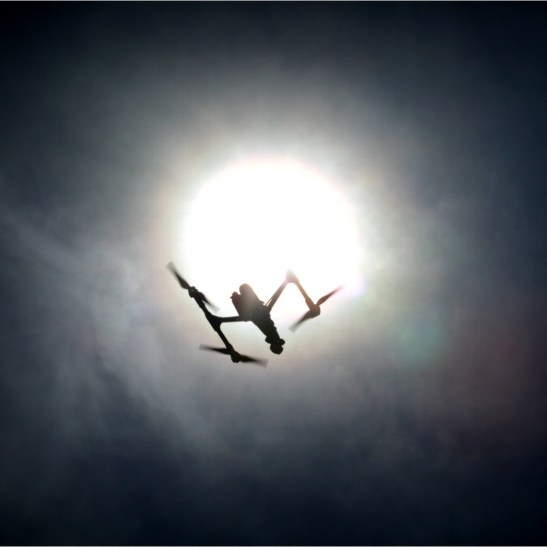 Our products look down, but have you ever looked up?  Check out Freeway Drone's picture of the #DJI #inspire1 trying to eclipse the sun.  Learn more about the inspire 1 today: www.dji.com/inspire-1  #IamDJI