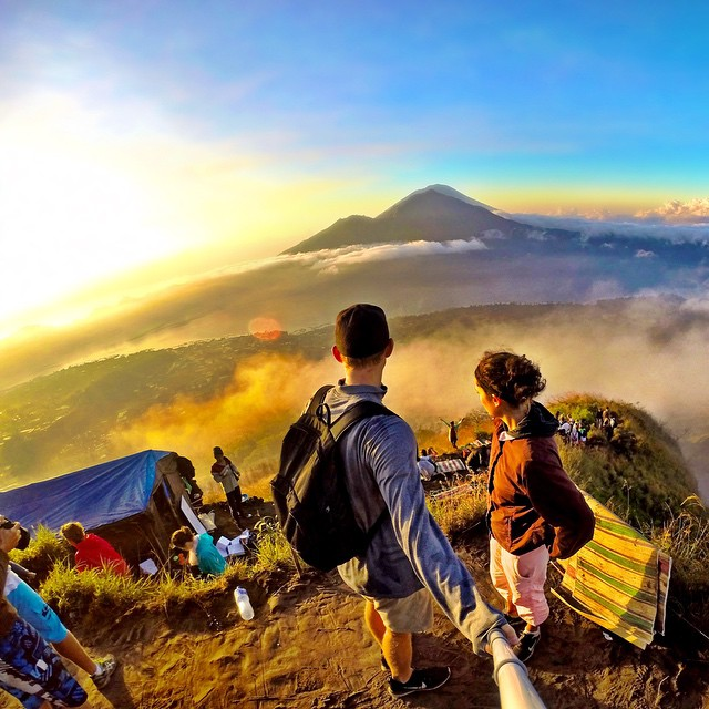 @justinwoodman left his hotel room at 2 a.m. and hiked in total darkness to be on top of Mount Batur, an active volcano in Indonesia, for an epic sunrise selfie. GoPro HERO4 | GoPole Reach #gopro #gopole #gopolereach #sunrise #indonesia