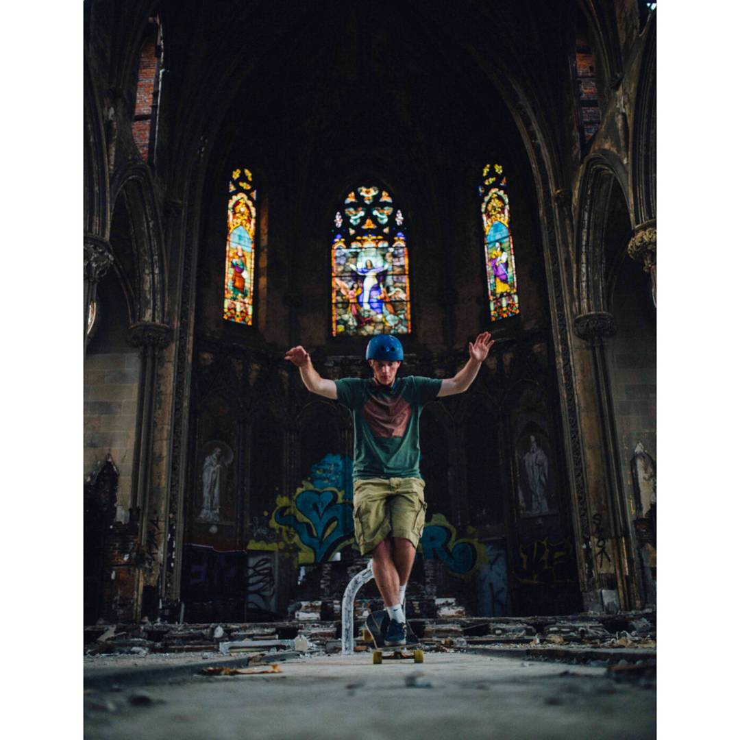 @AlexMckenzie180 creeping a nose manual through a decrepit abandoned church on his #Loaded #Overland Photo: @jonsevik #LoadedBoards #Orangatang #yellow #fatfrees
