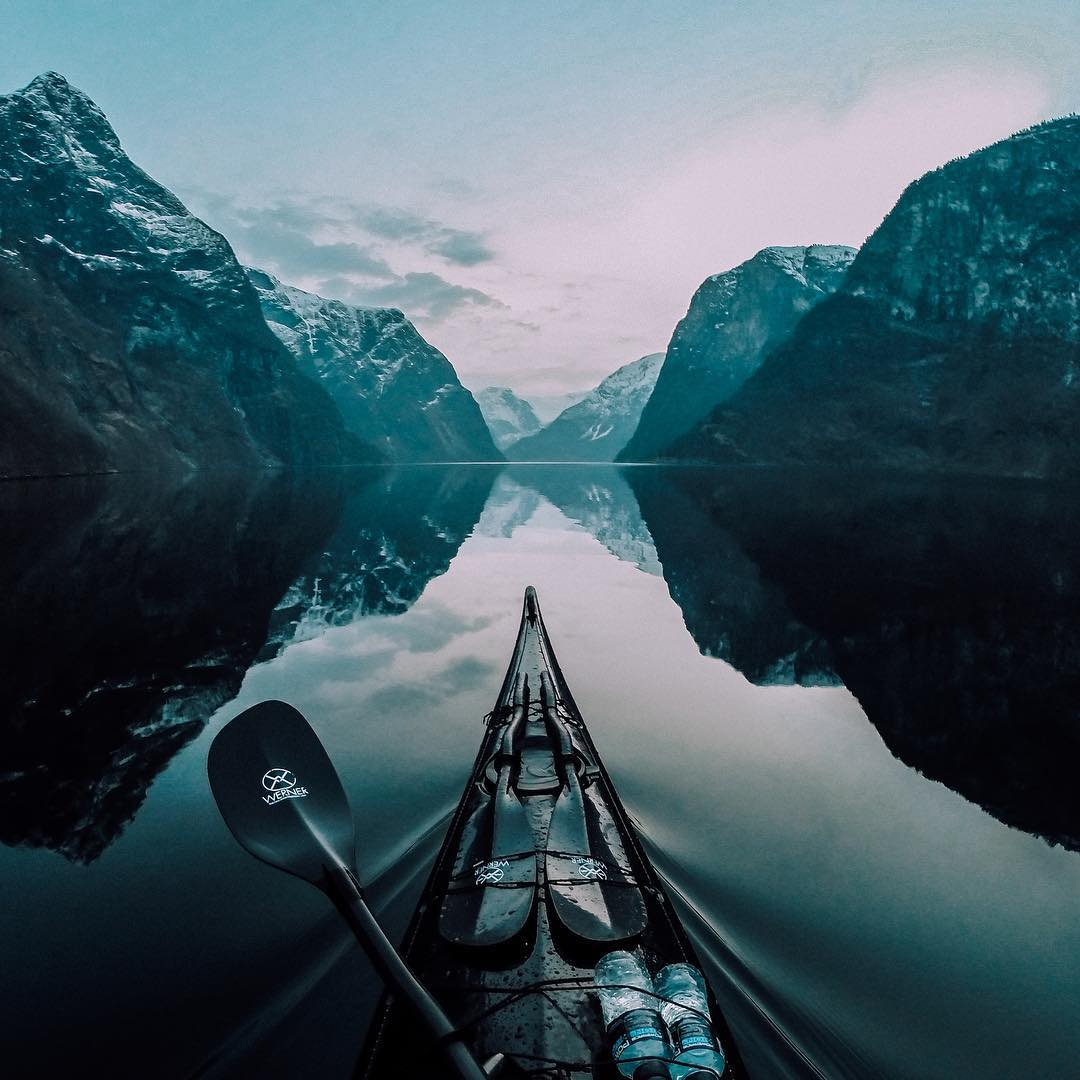 Photo of the Day! @tfbergen glides through the Nærøyfjord in Norway after the sunset. Submit your best photos by clicking the link in our profile. #GoPro #Kayak