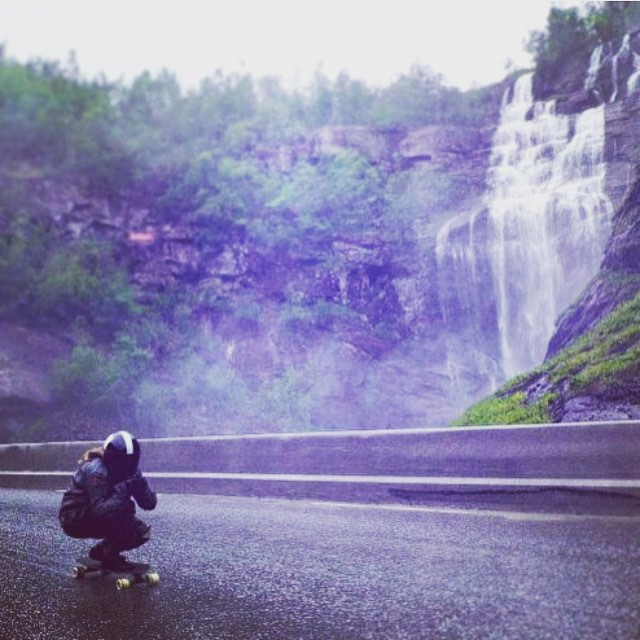 Epic is epic. LGC Norway Ambassador @lorenzadw some weeks ago racing #Voss.  The view is kind of ok.  Erkki Rustad photo.  #longboardgirlscrew #womensupportingwomen #girlswhoshred #skatelikeagirl #loranzawalker #norway #waterfall