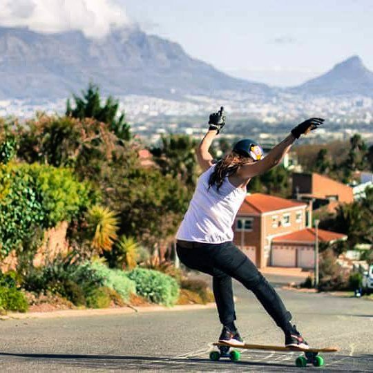 @andreakatzeff styling a standie amongst a beautiful Cape Town backdrop.  Photo: James Blyth #girlsthatshred #longboardgirlscrew #skatelikeagirl