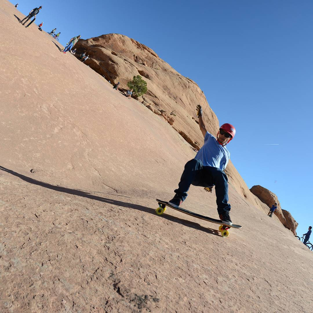 #OrangatangAmbassador  @ethancochard trying to not fall on the slick rocks of Utah.  Photo: @alex_kubiak_ho_chi  #DenizensOfThePetrifiedSandDunes #LoadedBoards #yellow #stimulus