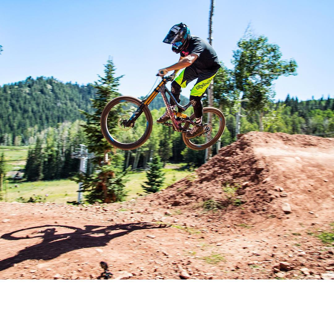 Cambered turn to cutaway jump - so much fun. As a rally driver, I really get stoked on features like this! Great downhill MTB session this past Wednesday here in #ParkCity on my @IamSpecialized S-Works Demo 8 bike. Minus the whole...