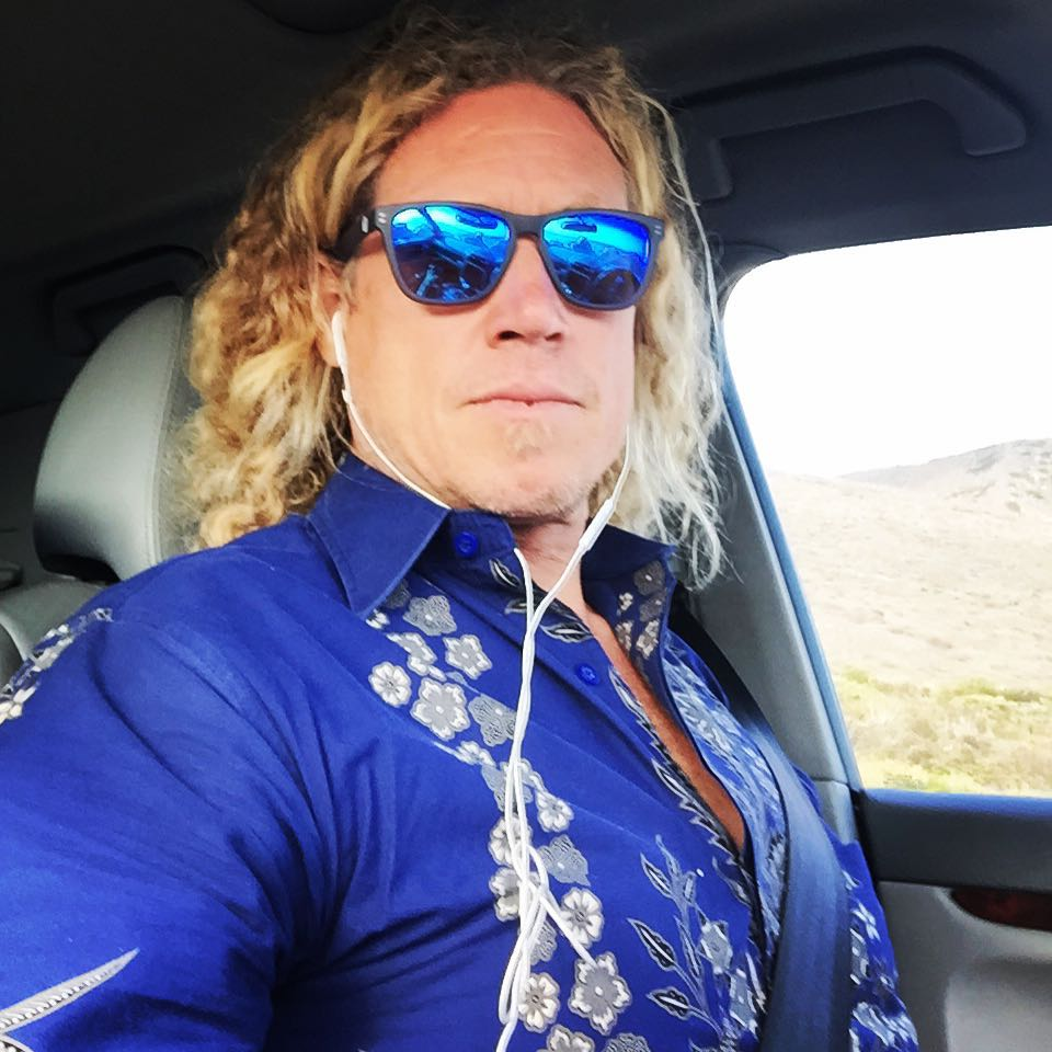 Wave Tribe founder spotting sporting balinese ceremonial shirt and looking dapper.