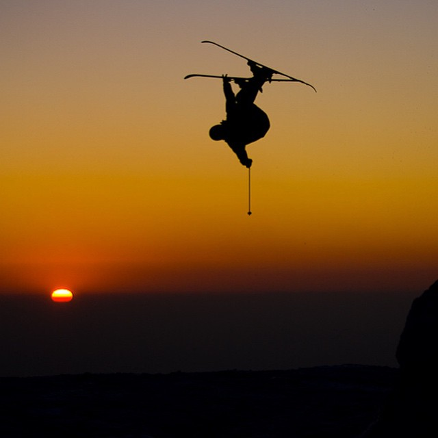 Flying high over a Chilean sunset skier: @anna_segal || #xshelmets #chile #southamerica #skiing #sunset #silhouette #freeski