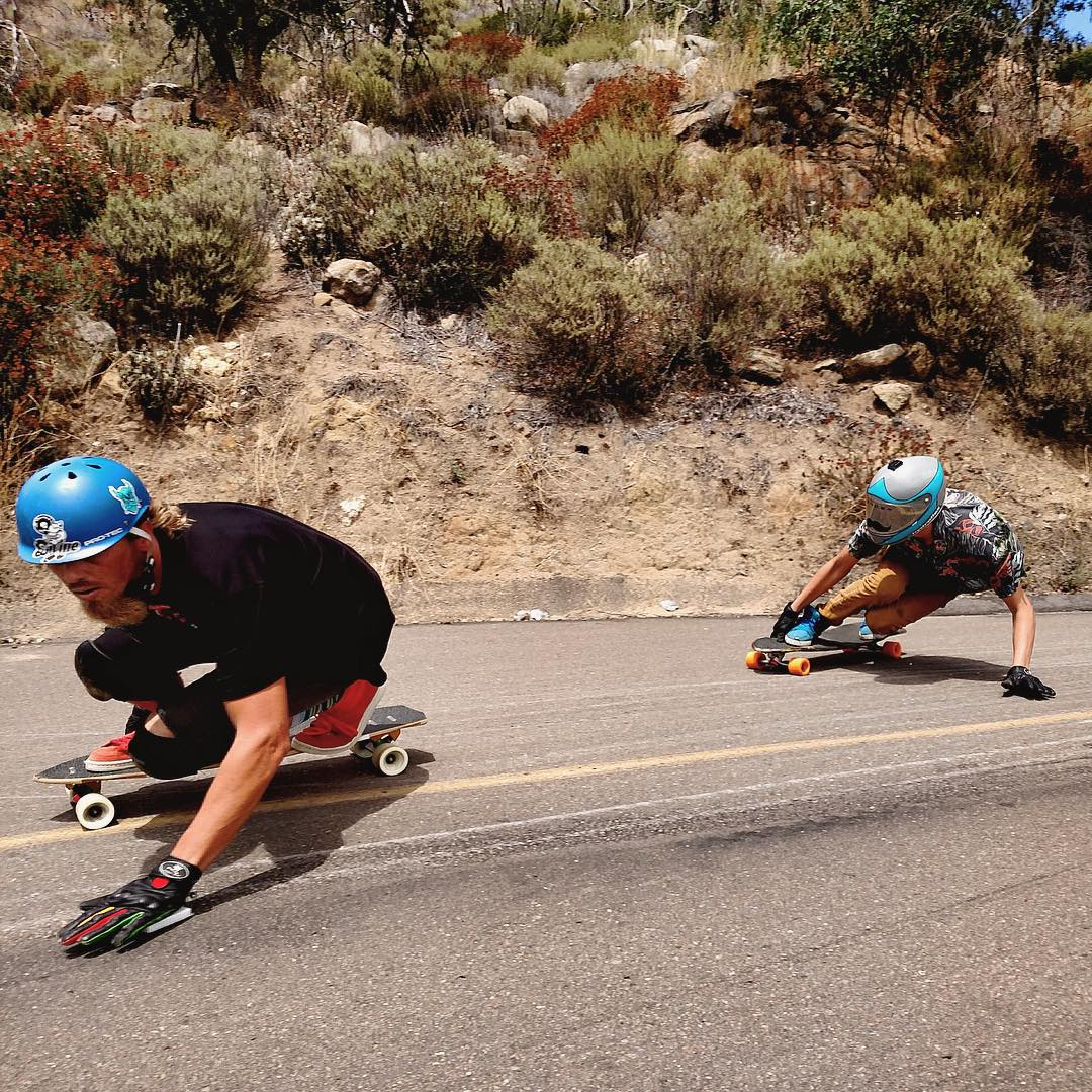 Weekends are never long enough. @lonniesk8 and @_sam.jones__ make the most of theirs skating fast and tight on roads that nobody knows. #divinewheelco #divinewheels