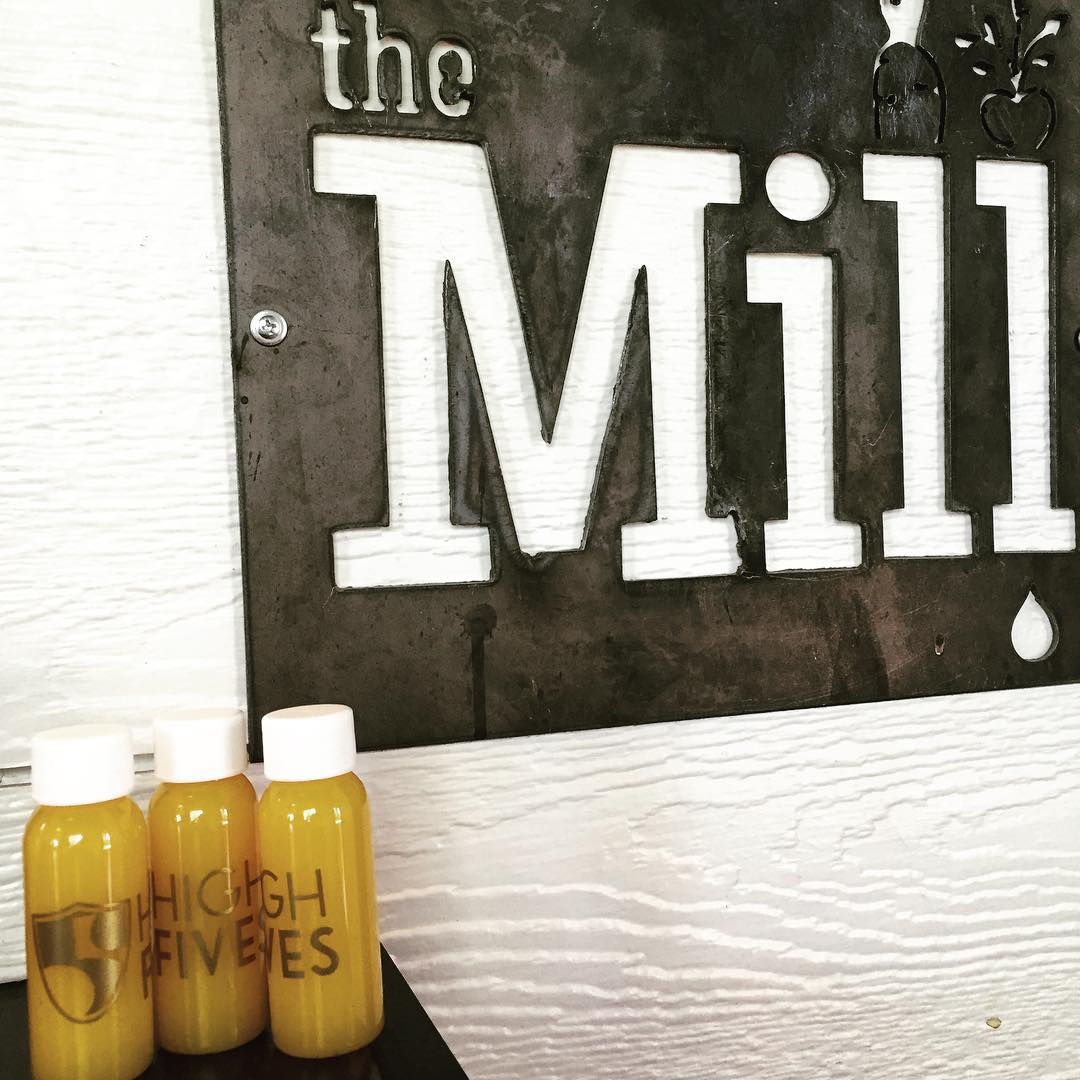 Fuel your day with a High Fives shot from the @themilljuiceshop! For every High Fives shot sold $2.50 goes towards a #highfivesathlete. #turmeric #ginger #pineapple #orange