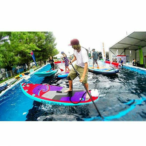 Showing off the new boards at the demo pool at @outdoorretailer . @currentdrives put a battery powered propeller on the #HalaAtcha ! #atcha86 #halaluya #haladaze #halapeno #ORshow #pooldemo #ORSM15  Photo: @suppaul_pics