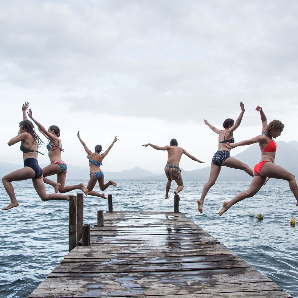 A day to remember.  Awesome shot of @threadcaravan trip participants dock hoppin' into Lake Atitlan by @karimiliya.