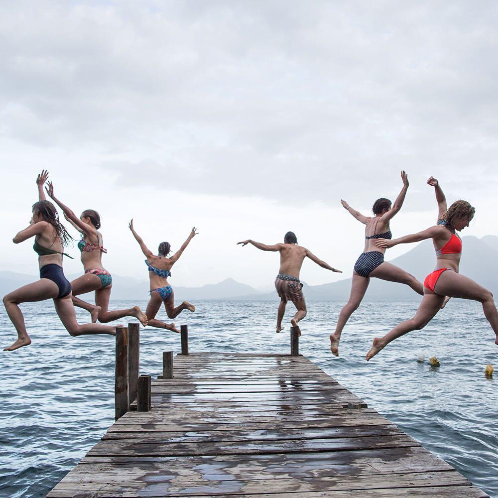 A day to remember.  Awesome shot of @threadcaravan trip participants dock hoppin' into Lake Atitlan by @karimiliya.