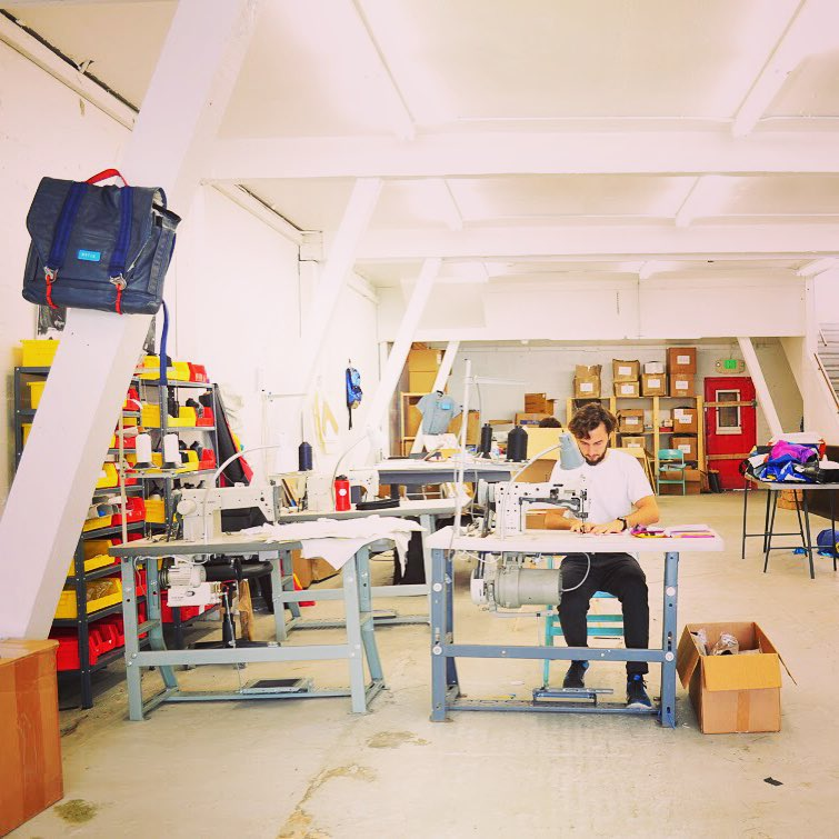 "Working from our new space in #SoMa // The bag on the left is a sneak peek on ""Thanks for flying with Mafia"" project. #fromairplanestobags"