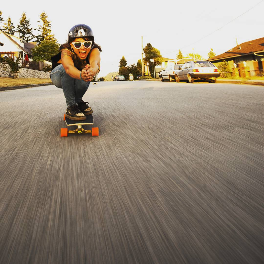 #rayneteam rider @chelagiraldo sunset cruising on her #rayneforge with her signature good vibes and surf style.
