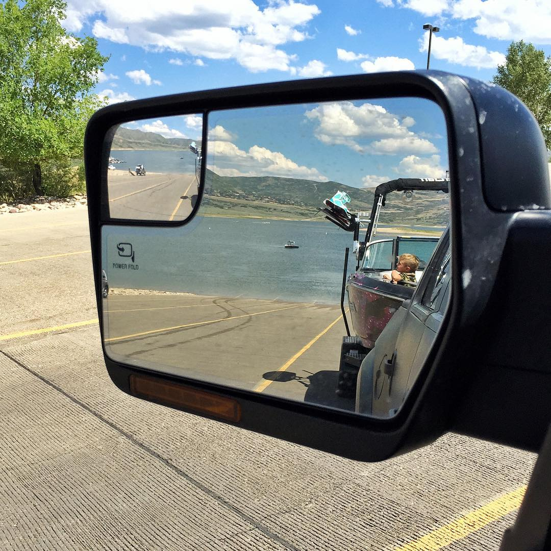 This happens to be one of my favorite side-mirror views. Boat, Raptor, family, mountain reservoir. Yesterday was a good day at the lake. #mountainparadise #homelife #FordRaptor #MasterCraft