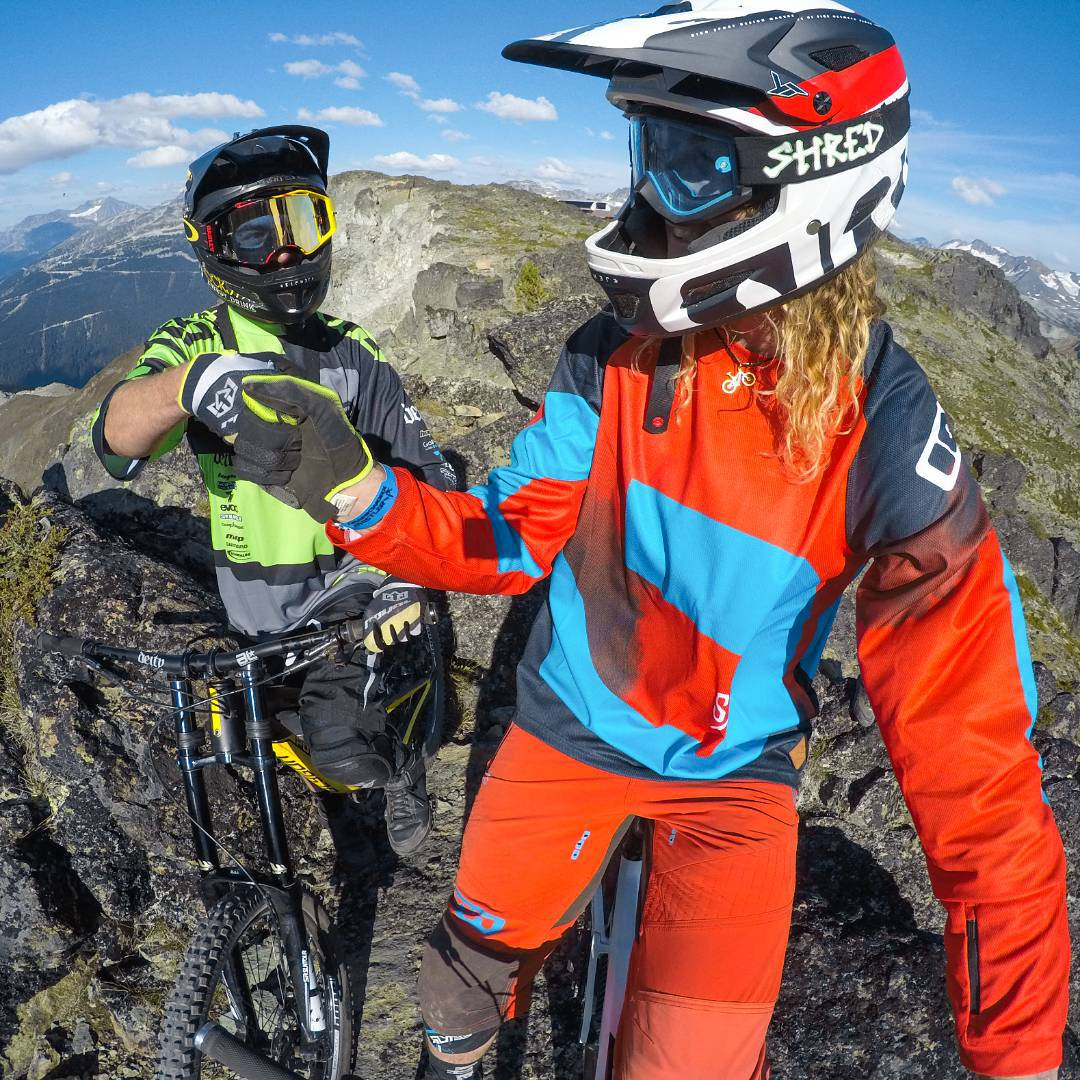 There's no place like Top of the World Trail at @whistlerblackcomb! @kellymcgazza and @kurtsorge share a fist bump before shredding the gnar at #Crankworx. Tag a riding buddy for a chance to win a #HERO4Session. #GoPro #Whistler