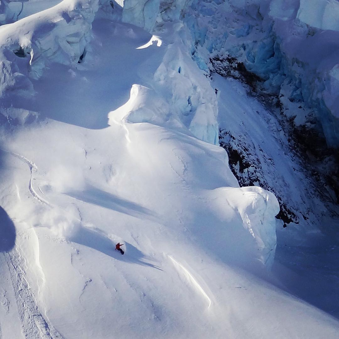 #tbt Hot summer days get me thinking about snowboarding. This is a shot I took  of #AV7Renegade @sethwescott hauling ass through some glaciers in Alaska. #avalon7 #liveactivated #snowboarding #@llbean @wintersticksnowboards www.avalon7.co