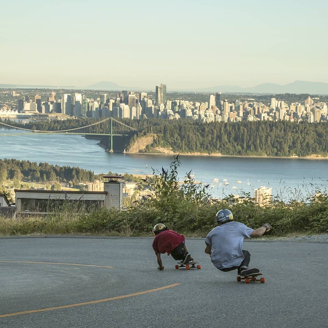 #OrangatangAmbassador @sho_ouellette leading the charge through a corner over looking Vancouver with @azanzamike following that booty nice and close.  It is a peculiar thing, downhill skateboarders fascination with their long time friends...