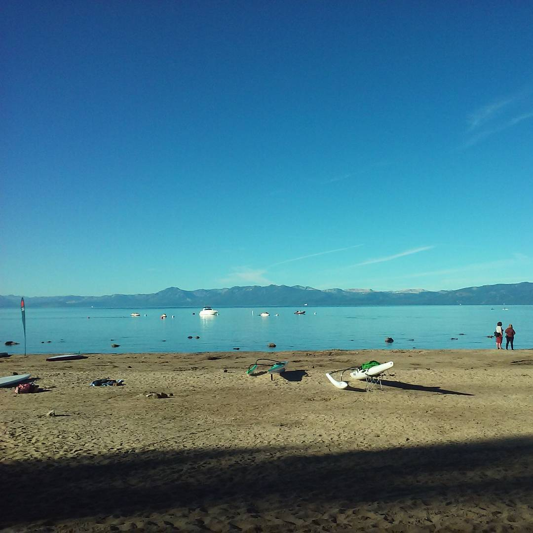 Rough day at the office! We're in Kings Beach this weekend for the Tahoe Nalu Paddle Festival. #Tahoe is like glass this morning! Stop by for sup heaven and #Ca89 clothes.