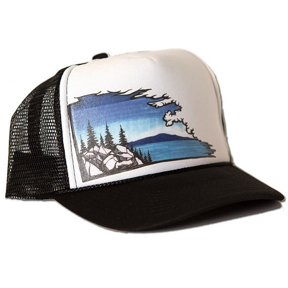 Have you seen this new hat yet? The lake cloudshape hat. #truckerhat #risedesigns #tahoe #lake #trees #rocks Available now on our etsy site. Risedesigns.etsy.com