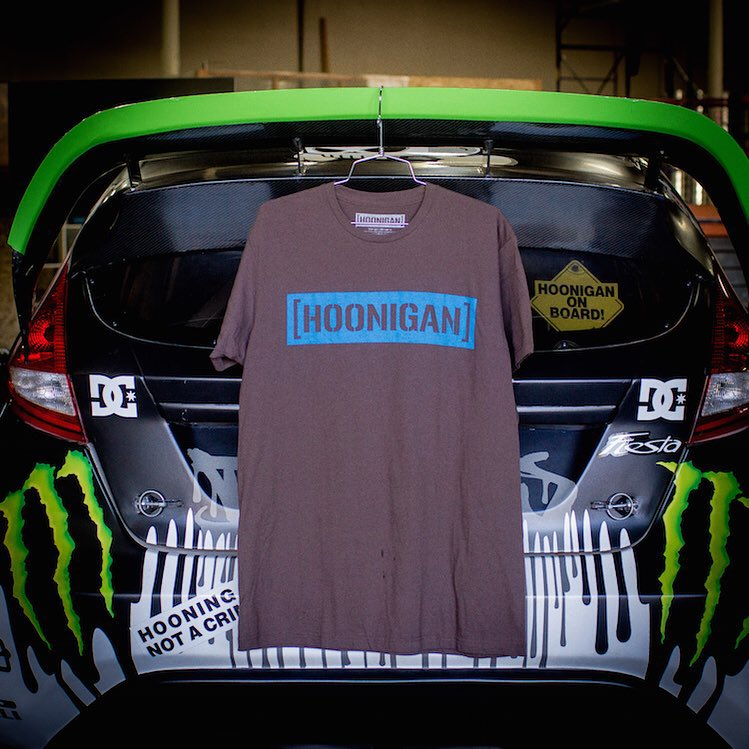 We got two new arrivals at the #donutgarage this week, this Cyan and Brown C-Bar Tee now available on hoonigan.com (click link in bio) and @Kblock43's Gymkhana THREE Fiesta that will be on display for the grand opening of the #hngnbakery on September...