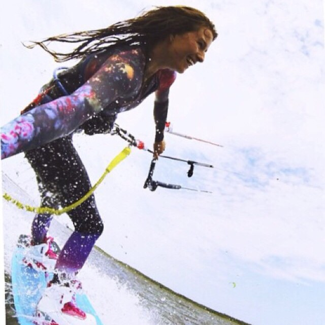 Sun protection at its cutest! @_sophiemathews rocking the zip front rash guard in Galaxy. #kitebabes #kiteboarding #girlswhorip
