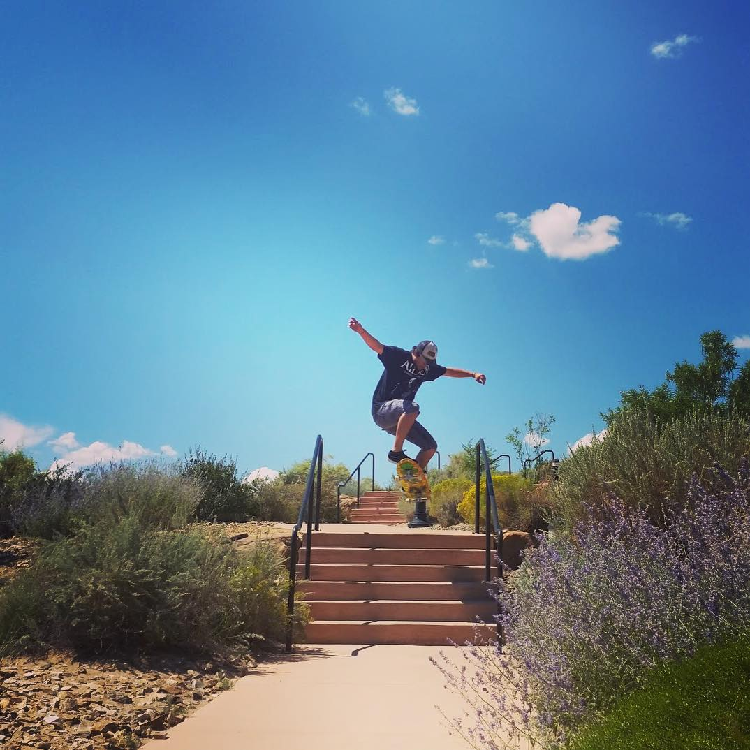 James Tracey--@deadbear13 ollies a 6 stair on the Da Kine!