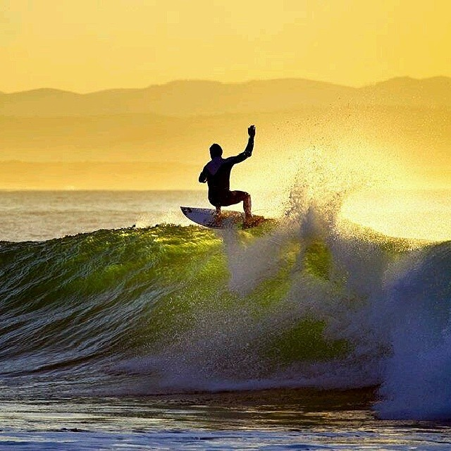 Break of dawn surfing.