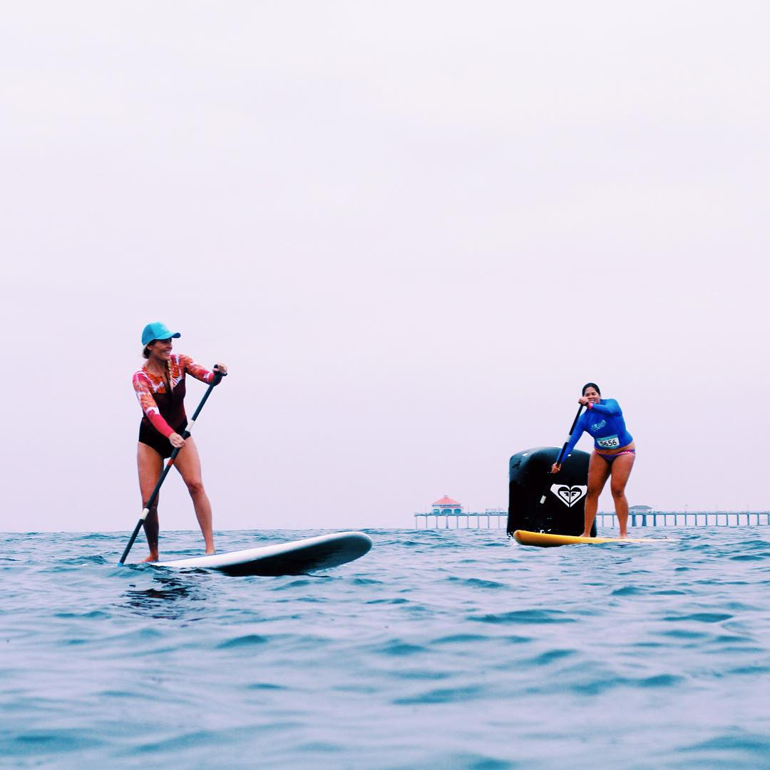 Signature @StephanieGilmore steeze makes paddle boarding by the pier look easy #RUNSUPYOGA  We want to tag our other friend in the shot. Anyone know her insta handle? Photo: @Sardelisphoto