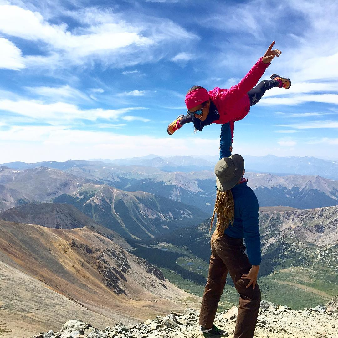 Flying high on top of a 14er with the @yogaslackers!