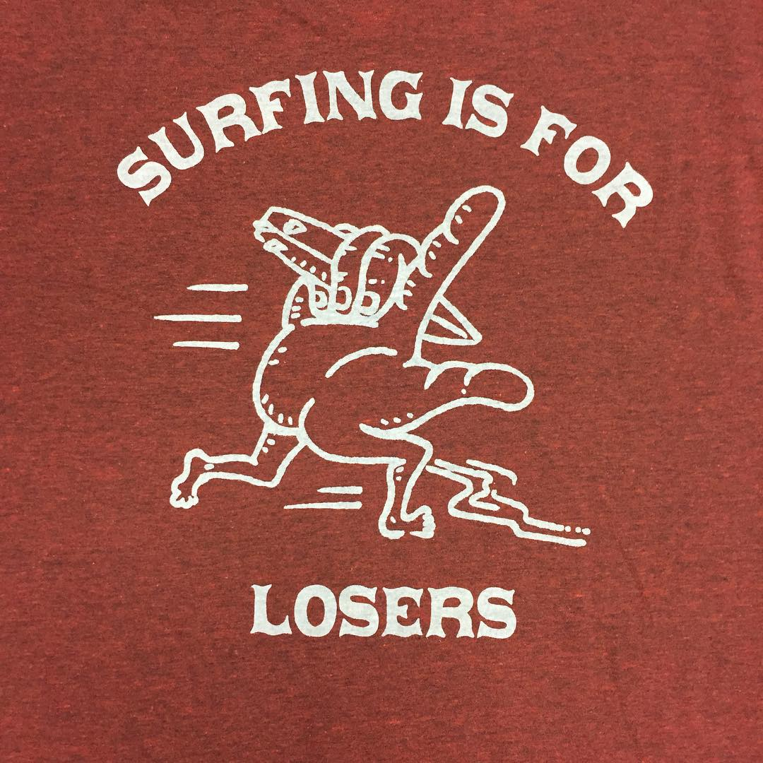 "New ...Lost ""Surfing Is For Losers"" tee. Available @7thstreetsurfshop @17thstboardshop @17thstreetsurf @adventuresportsmaui @arenasskatesurf @atlantic_shoals @billabongdeerfield @coastaledge @catalystcb @elspotsurfshop @hsssurf @jackssurfboards..."