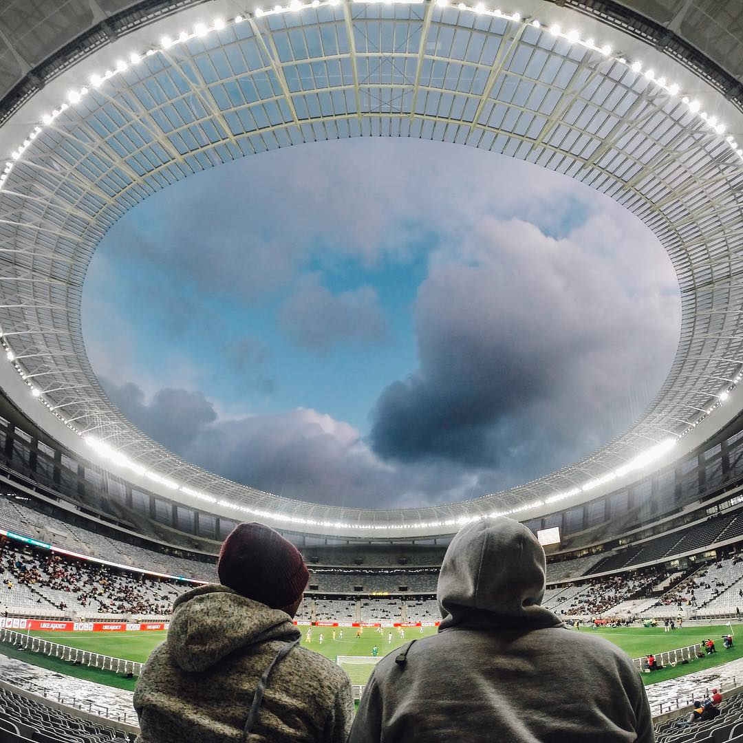 Photo of the Day! @alexw032 perfectly frames two friends taking in the Cape Town Cup in South Africa. Share your best moments with us by clicking the link in our profile. #GoPro #Football