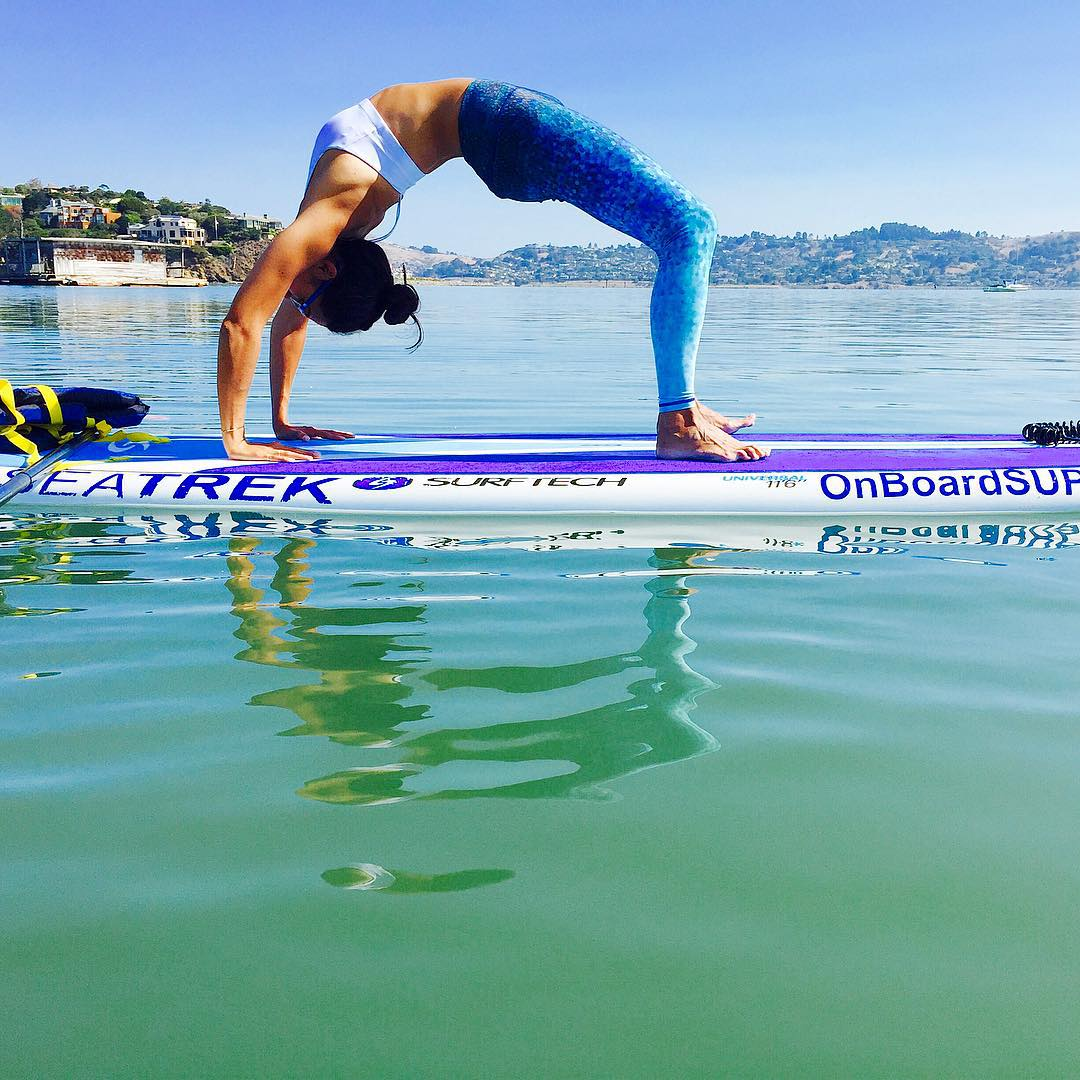 take a little time to reflect & be grateful  this is how the OKIINO team has a board meeting  #happyfriday #weekend #advendture #SUP #backbend #urdhvadhanurasana #supyoga #reflect #boardmeeting  #waterwoman #apparel #leggings #OKIINO