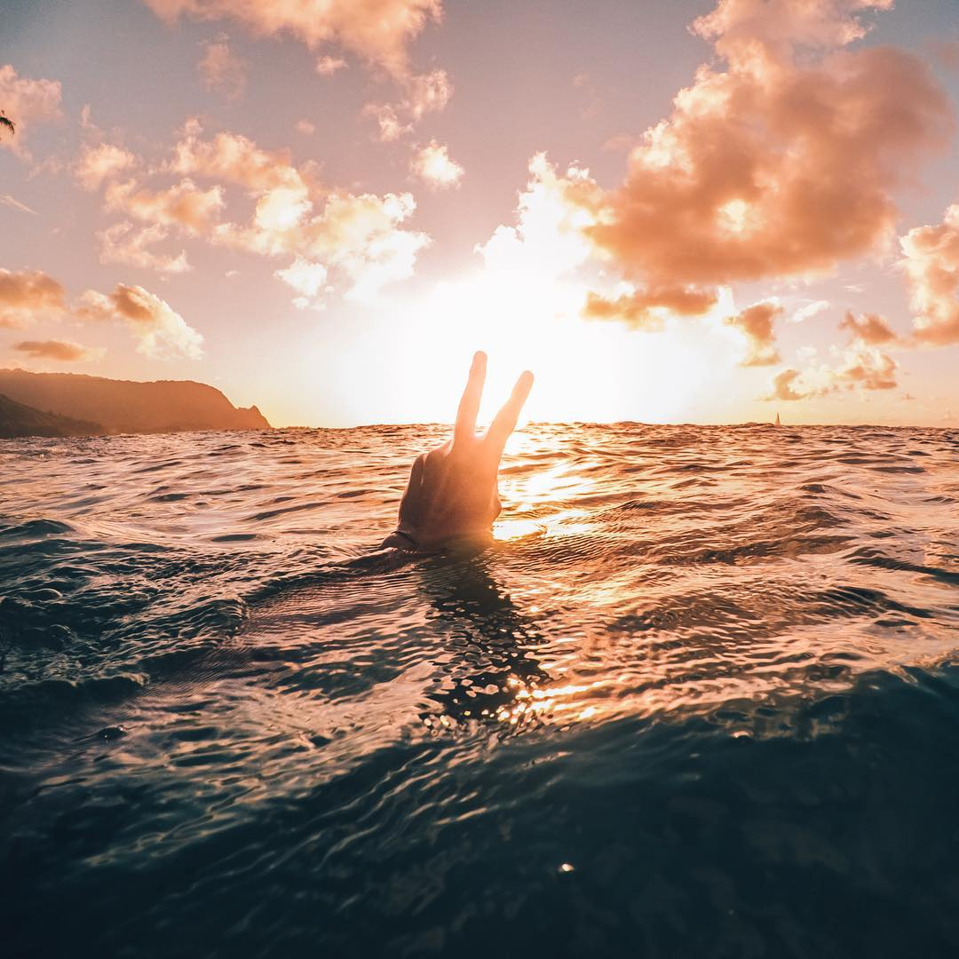 Photo of the Day! @thomaskovacik peacing out during a gorgeous Hawaiian sunset. Share your Sunday best with us by clicking the link in our profile. #GoPro #Hawaii #Sunset