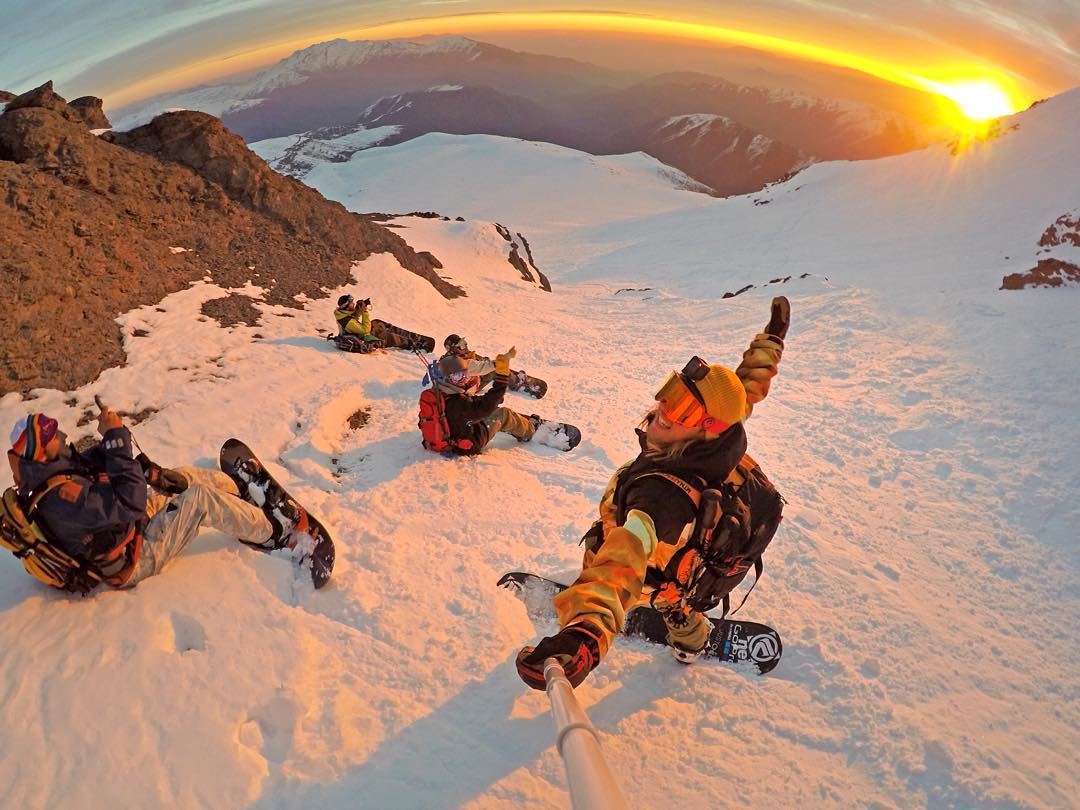 @timhumphreys taking in the sunset with the crew on top of the Andes Mountains in Chile. GoPro HERO4 Session | GoPole Reach @sndtours @flowsnowboardn #gopro #gopole #gopolereach #snowboarding #sunset #chile
