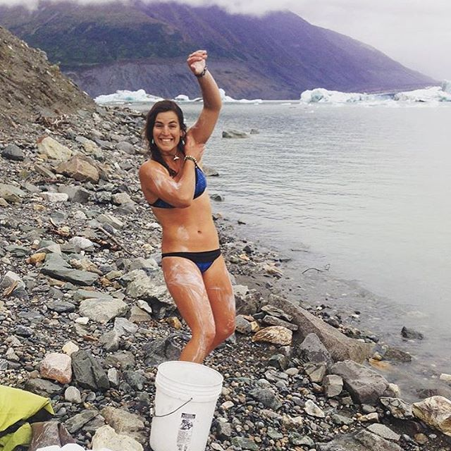 @nautilussup getting her bucket bath on during a rafting trip in Alaska!