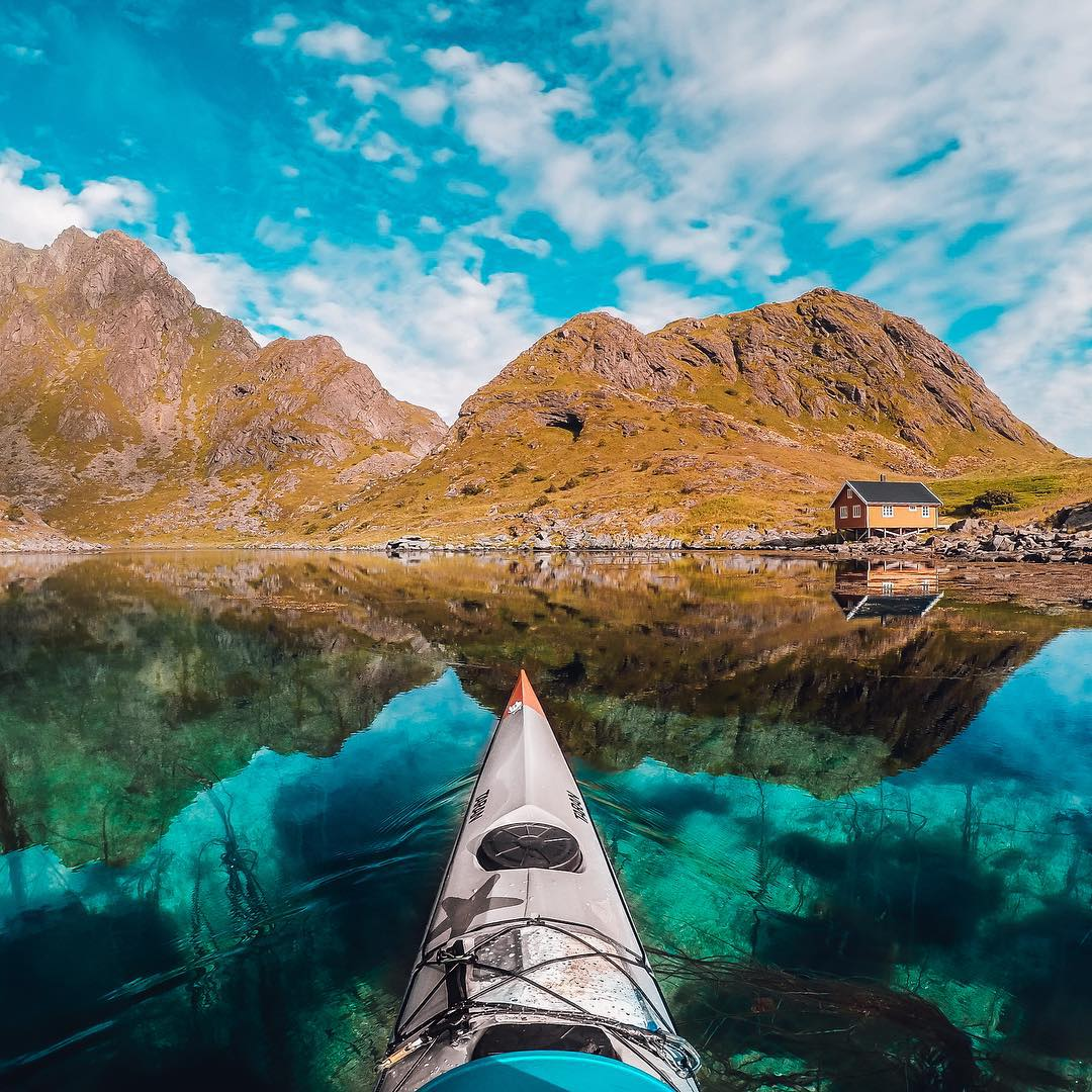 Photo of the Day!  A #kayak on the still waters of Lofoten, Norway. Image via @kristoffervan. Share your best shots with us by clicking the link in our profile. #GoPro