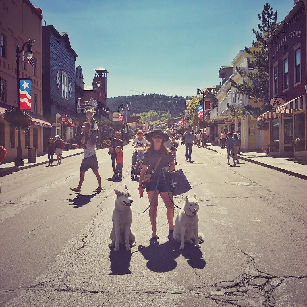 "My wife and our fur beasts on Main Street in Park City yesterday, post holiday parade and ""running of the balls"" event. Golf balls, to be exact. Ha. Exciting Labor Day in our home town, yesterday. #ParkCity #BentleyChickenFingersBlock #YukiTheDestroyer"