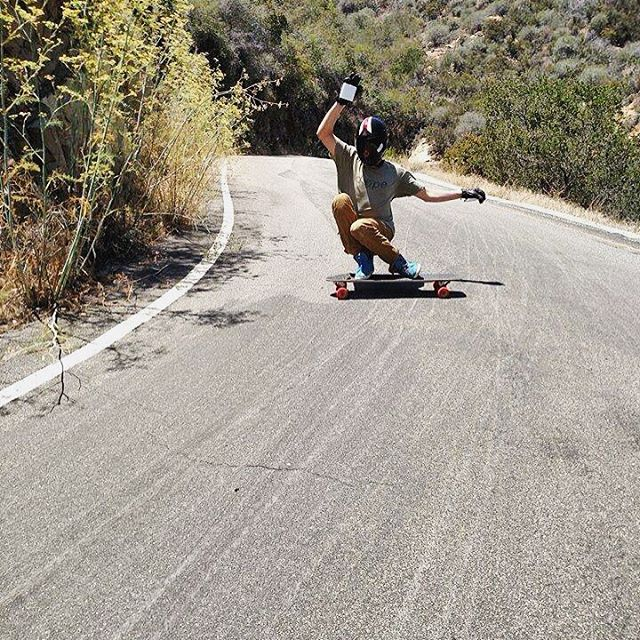 "Fun day in the hills, Divine Accomplice @_sam.jones__ aka ""Big Smooth"" tucks his knees with that no-handed style and rides a slide before a swooping righty.  #divinewheelco #divinewheels"