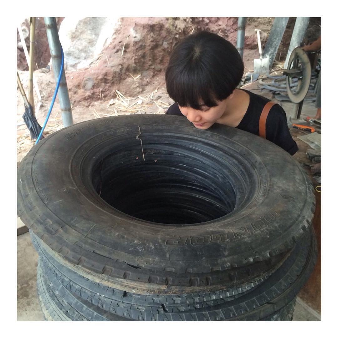 Our intern @perplexity curiously inspecting tires at the Indo workshop.