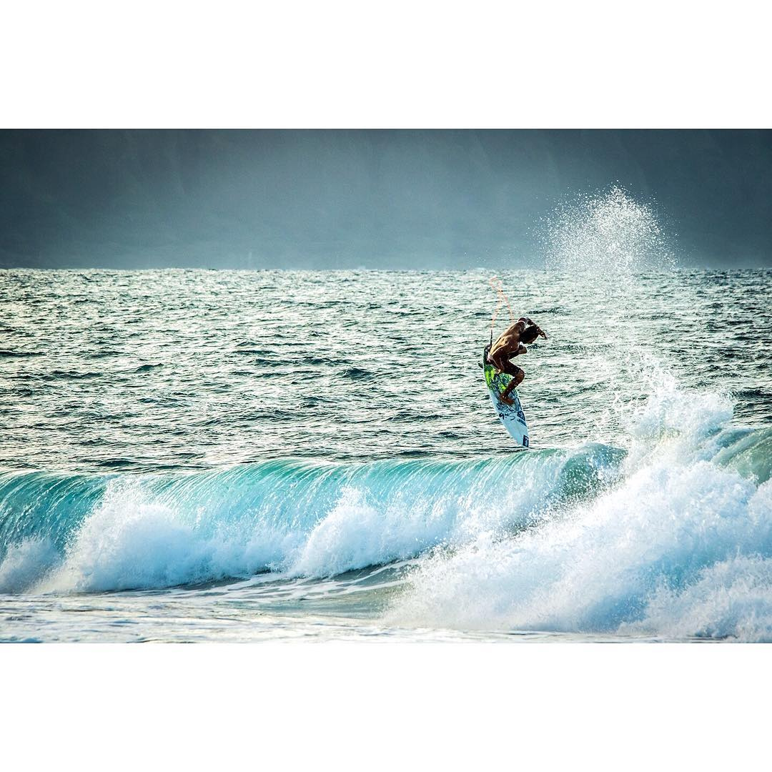 Soaring through the surf. Team Rider @kainoahaas showing us how it's done! PC: @instaclamfunk #hawaii #surf #inspiredboardshorts
