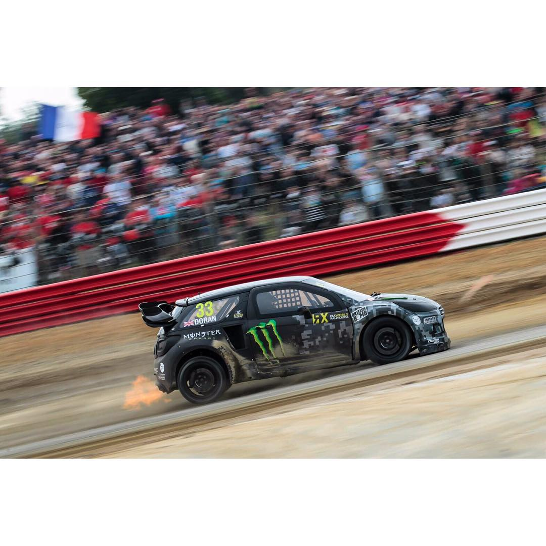 Here is a photo full of awesome.......my car banging out flames hard on the brakes.......and a whole ton of crazy passionate French fans loving every minute of it.....this is Rallycross!!!