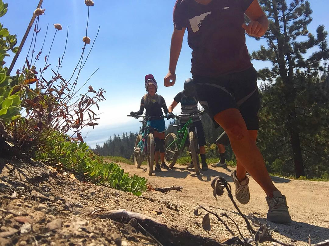 Last week's chilly weather had us amped on fall biking and #winter to come. #Tahoe peaking out in the background of infamous Tyrolian Downhill. #sisterhoodofshred #braaaaap #mtb