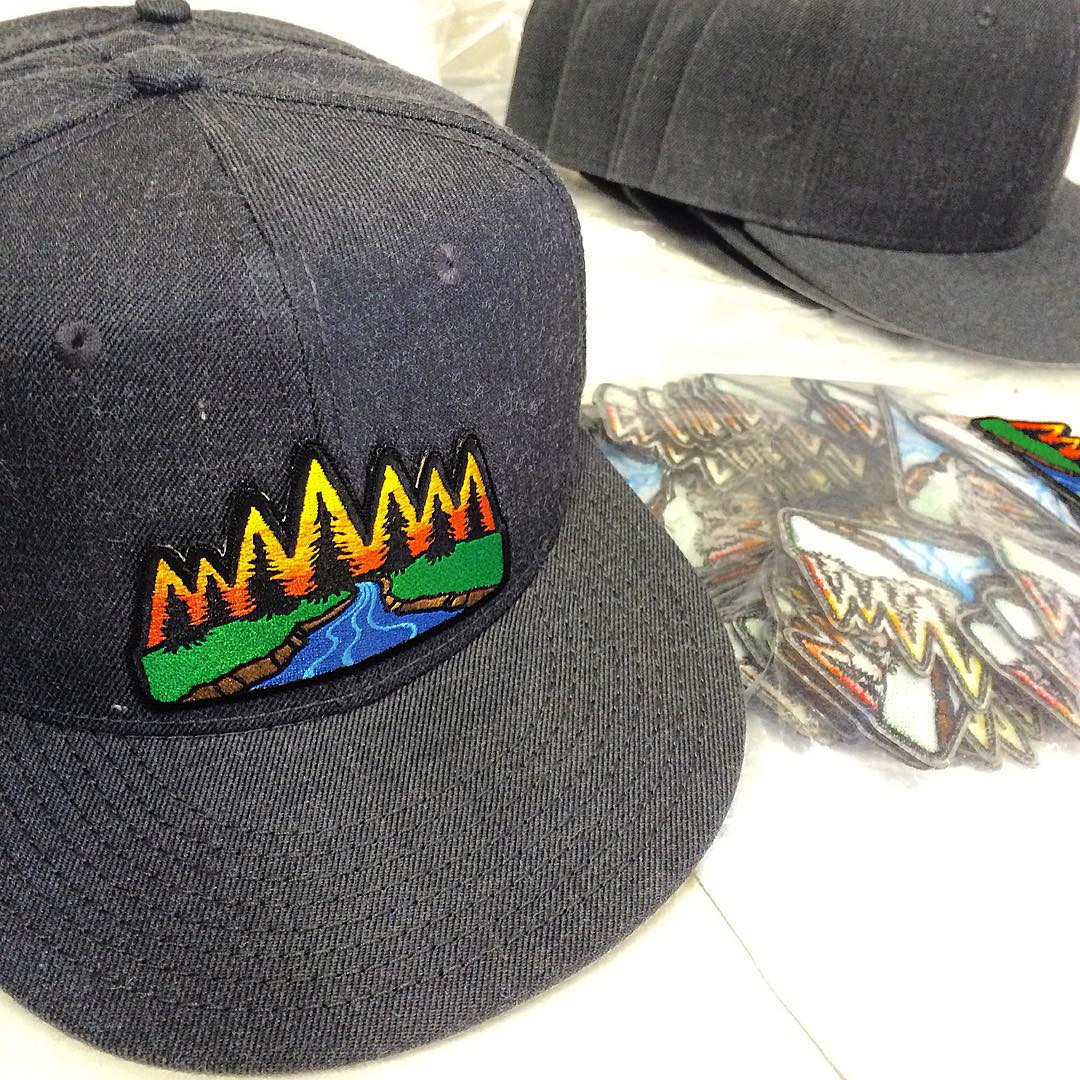 Making a new round of hats in the shop today. #risedesigns #tahoe #hats #riverscene #patches