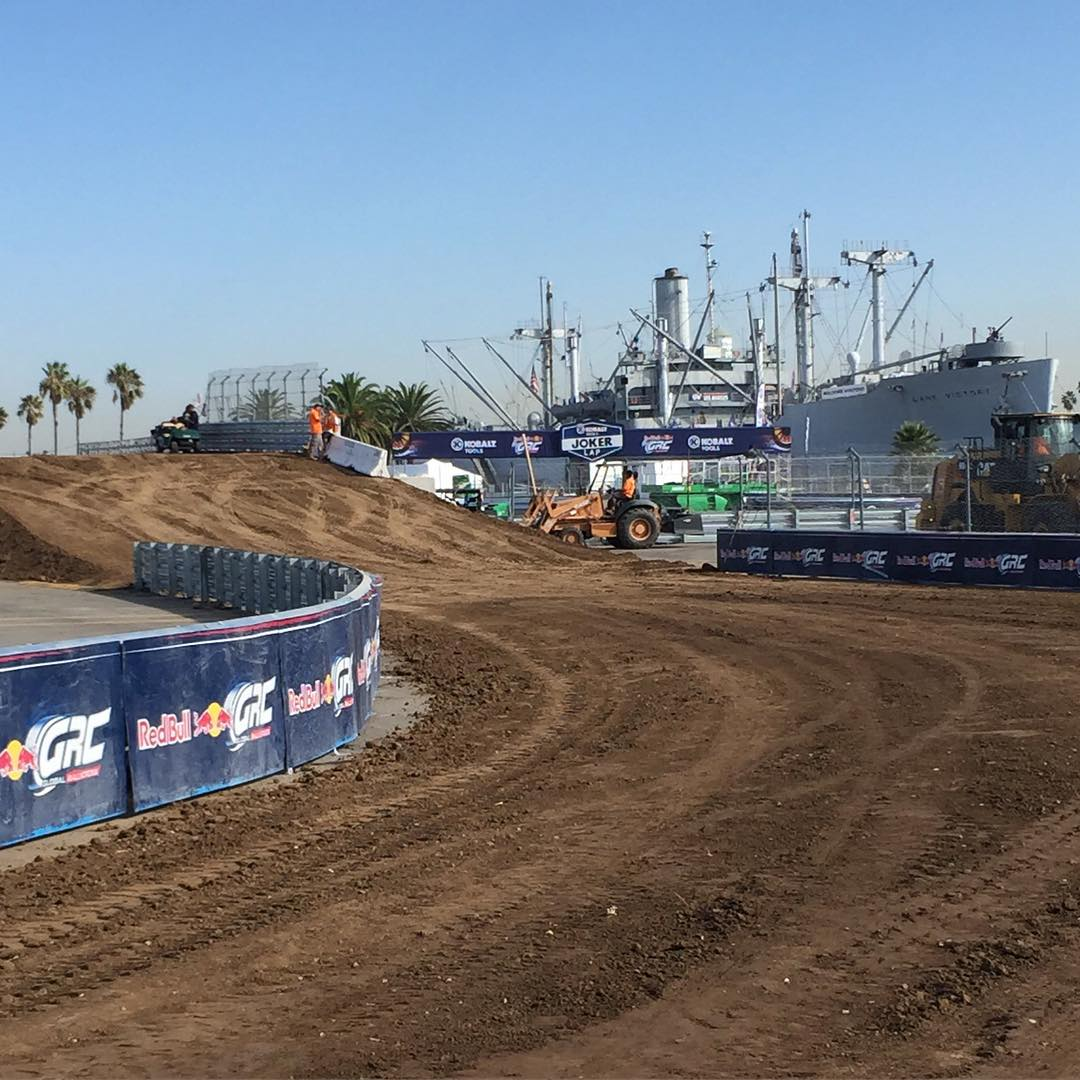 So I'm out on my bike to recce the course here at #GlobalRallycross Los Angeles this morning, and I see this: the crossover jump with a view of an old warship. I always appreciate a unique looking race course - massive military vehicles definitely help...