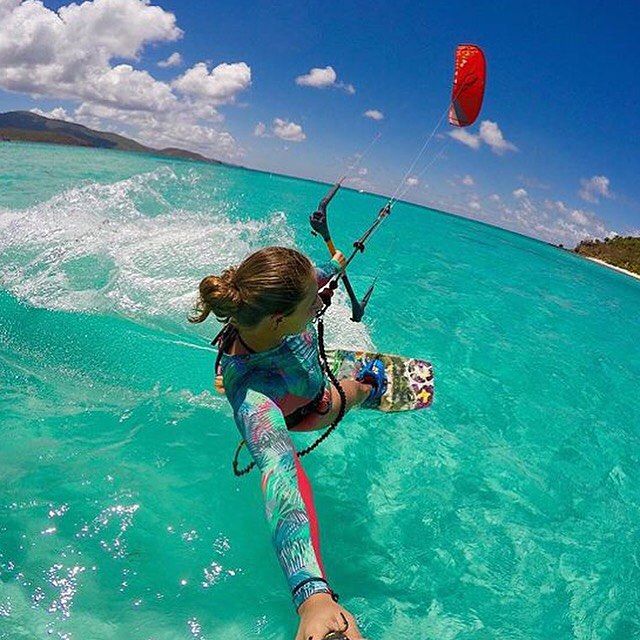 Enjoy the ride! @briannahirsch taking the surf suit for a spin around Necker island. #kiteboarding #jointheadventure