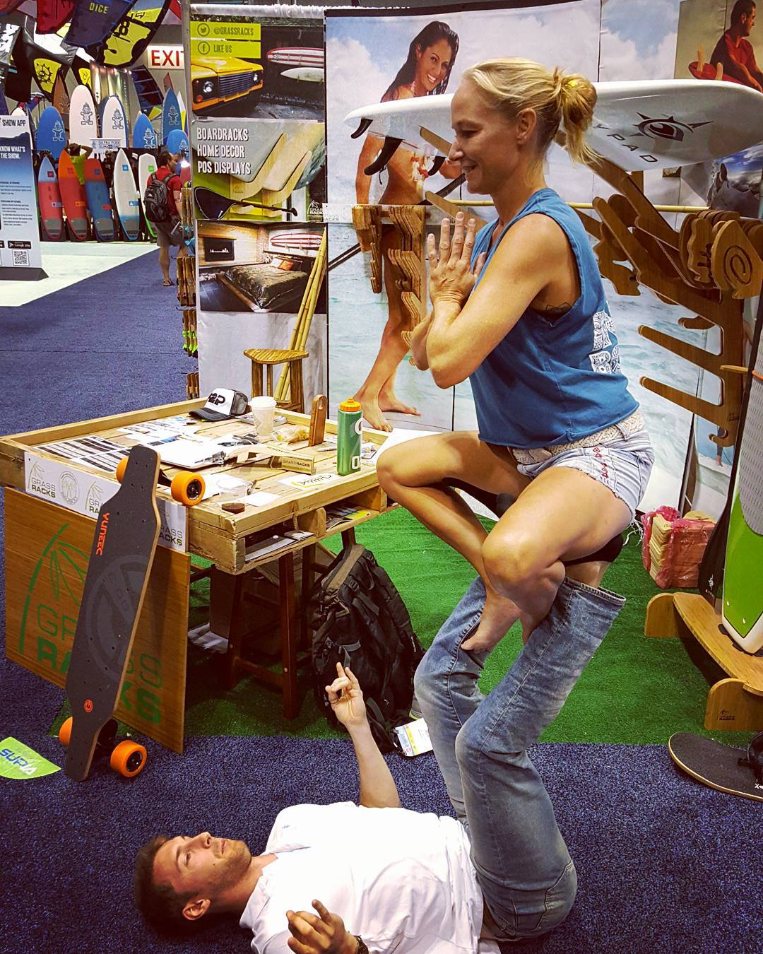 Successfully acro'd with (and didn't drop) @heathertleo!  Last day at expo, many demos to be sold. Come b(u)y and leave happy. BOOTH 868  #surfexpo #SURF #surfer #bamboo #boardracks #boardrack #yoga #acroyoga