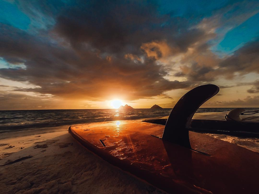 Photo of the Day!  The best way to start a Sunday. @rontinentalair captured this Hawaiian #sunrise before a morning paddle. Share your Sunday best with us by clicking the link in our profile. #GoPro #paddleboard