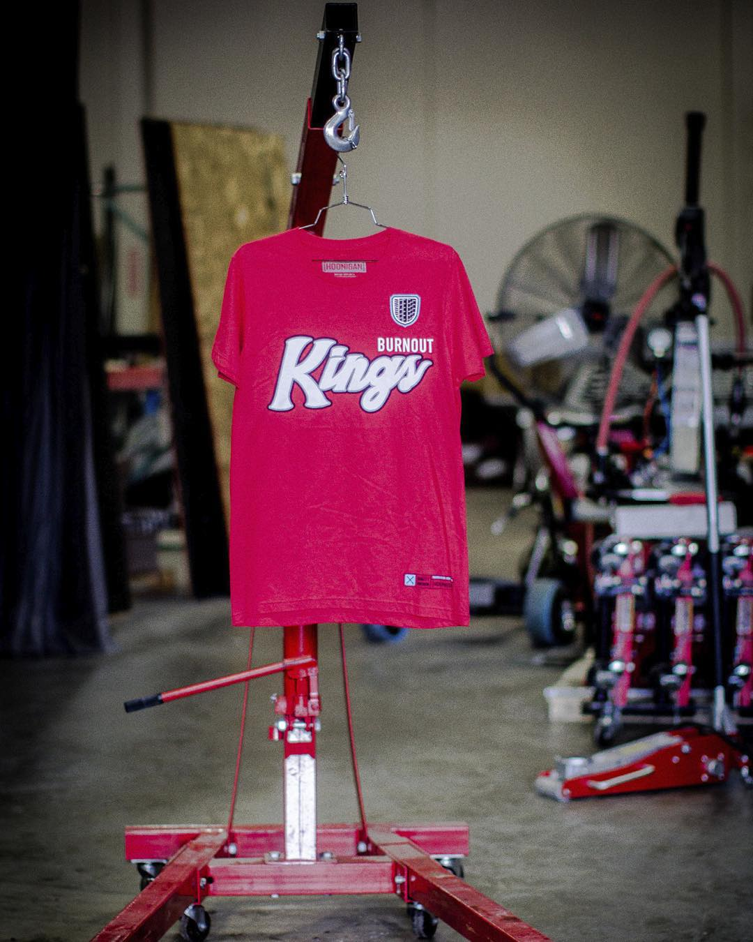 The #HNGN #DonutGarage engine hoist, not currently in use. That won't last long, kinda like this red #BurnoutKings Tee - available on #hooniganDOTcom. #breakallthethings #motorsaredisposableright #rangerproducts