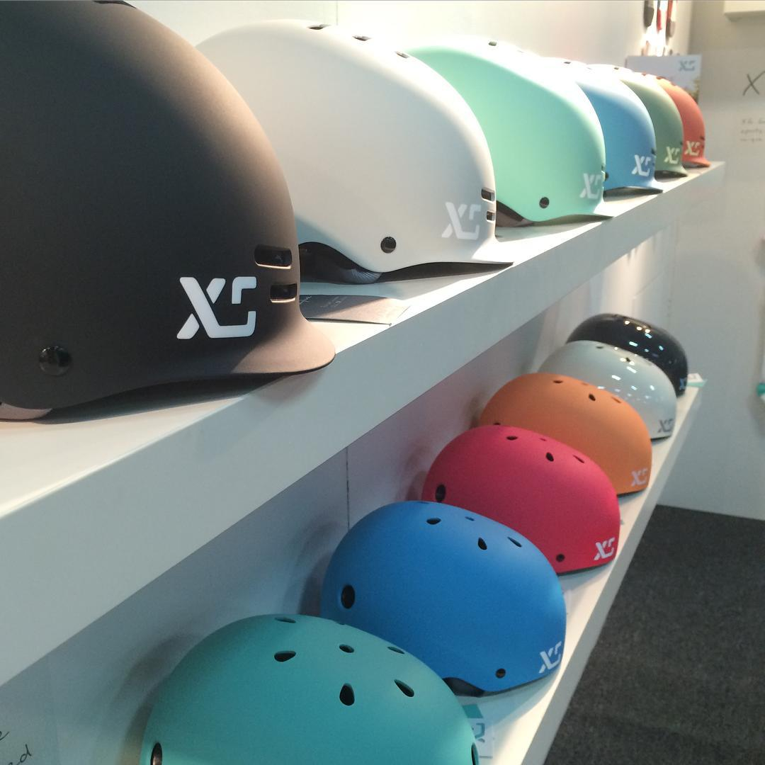 Skyline and Classic Skate helmets lining our walls @interbike #interbike2015 #xshelmets #bike #bikestyle #cycling