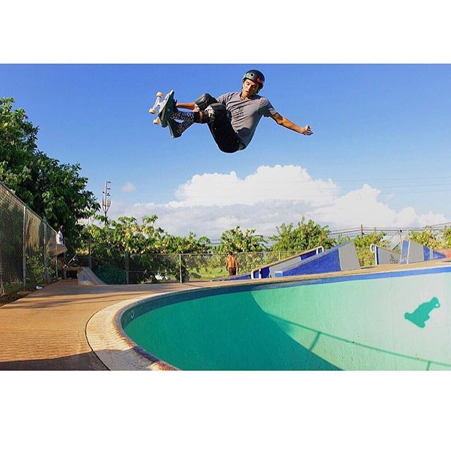 @properrideshop 's @heimana_reynolds floating a #frontsideair at #kapoleiskatepark . Heimana wears the S1 Lifer Helmet . #s1lifer #s1helmets #skatehawaii #bowlrider #skateboarding #justgoskate
